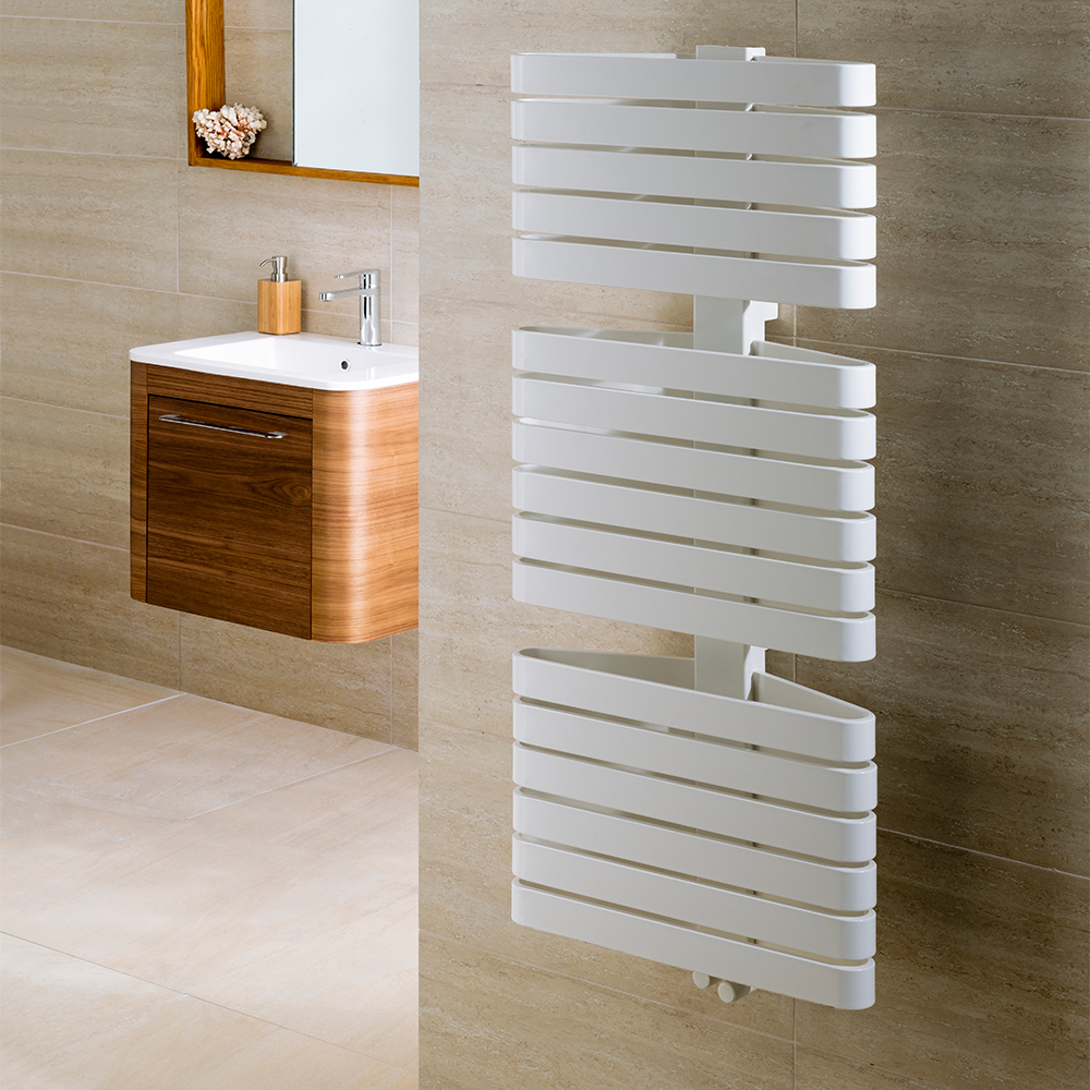 white triarc heated towel rail mounted in a tiled bathroom