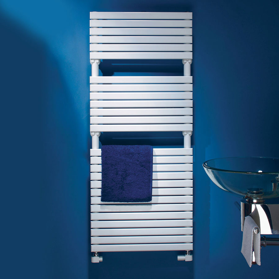 white designer heated towel rail mounted on a blue bathroom wall with a blue towel