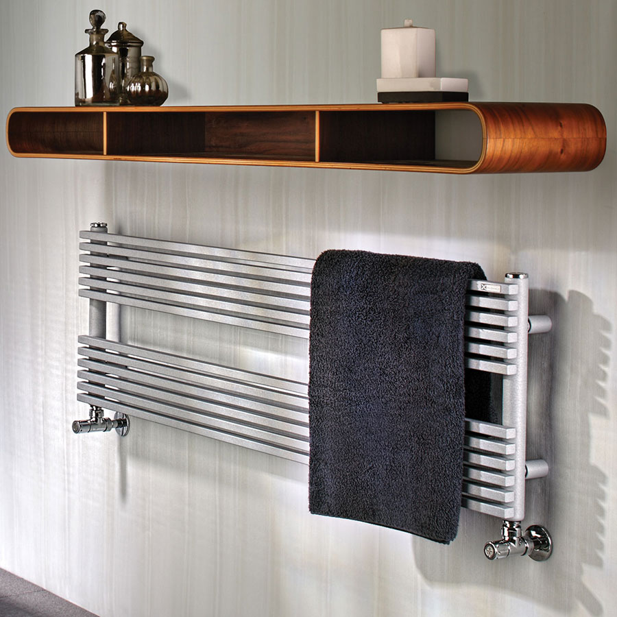silver horizontal heated towel rail mounted on a wall