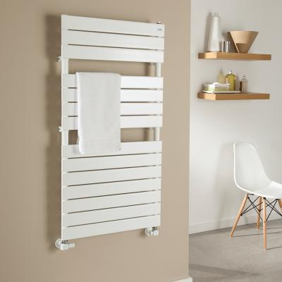 white picchio towel rail mounted on a beige wall next to a white chair